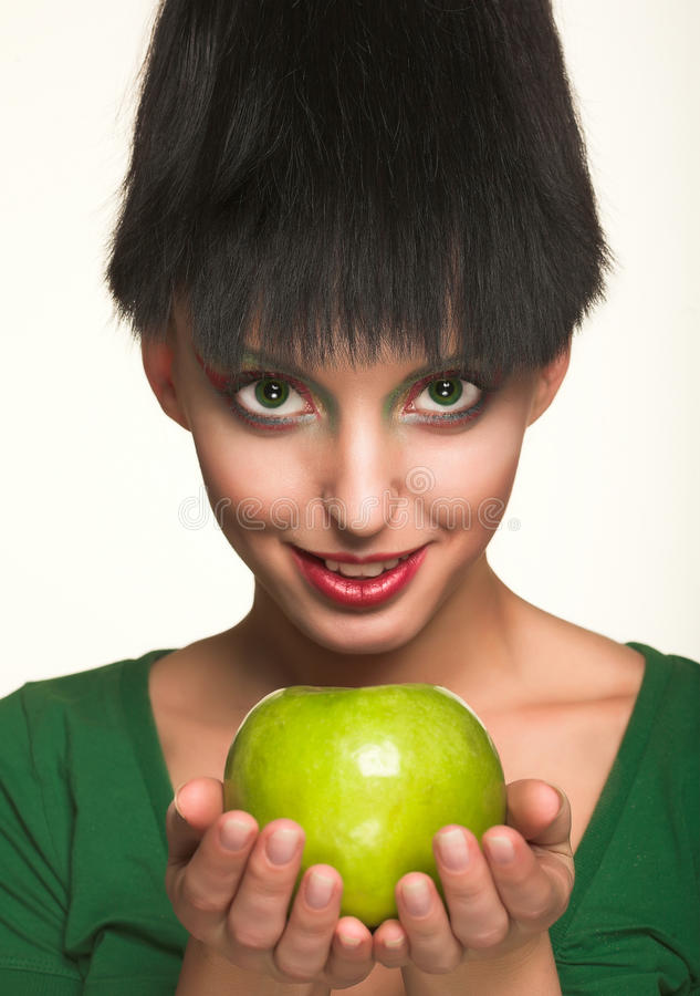Beautiful woman with apple. Isolated on white stock photos