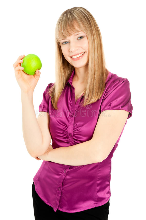 Beautiful woman with apple smiling isolated on white royalty free stock photo