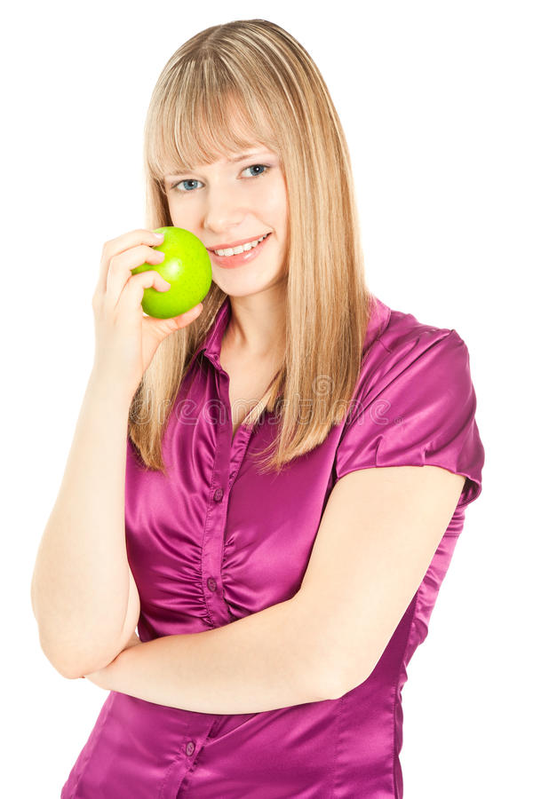 Beautiful woman with apple smiling isolated on white royalty free stock photos