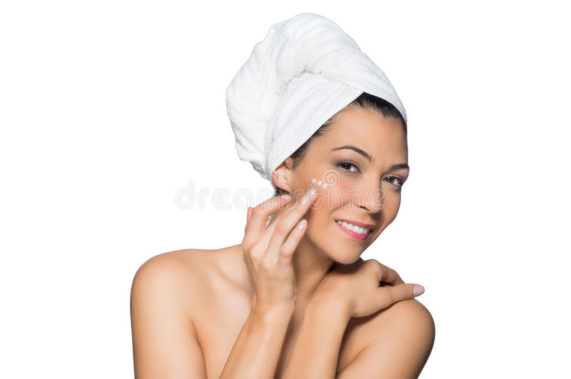 Beautiful Woman Applies Lotion to Her Face royalty free stock photos