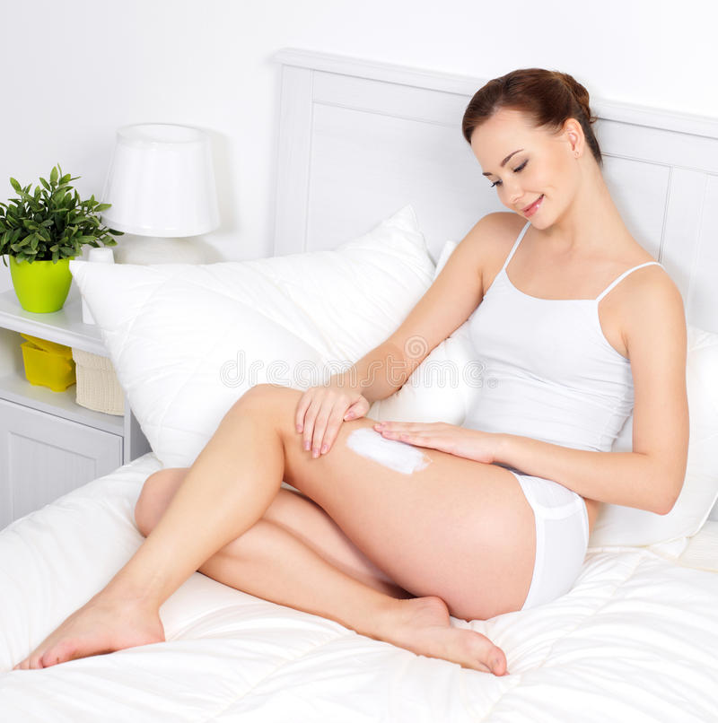Download Beautiful Woman Applying Cream For Skin On Legs Stock Photo - Image of care, home: 17270454