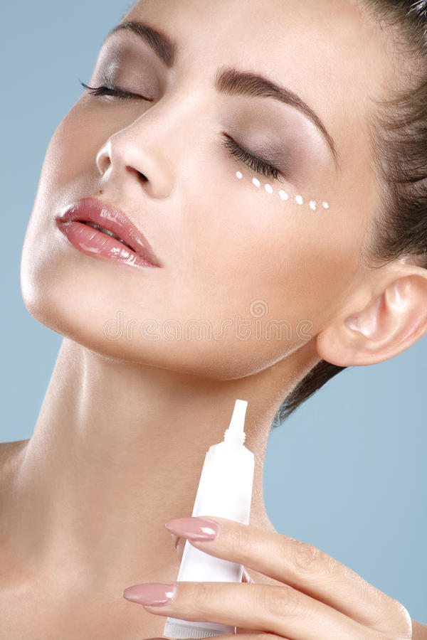 Free Beautiful Woman Applying Cream Treatment On Her Perfect Face Royalty Free Stock Image - 38202476