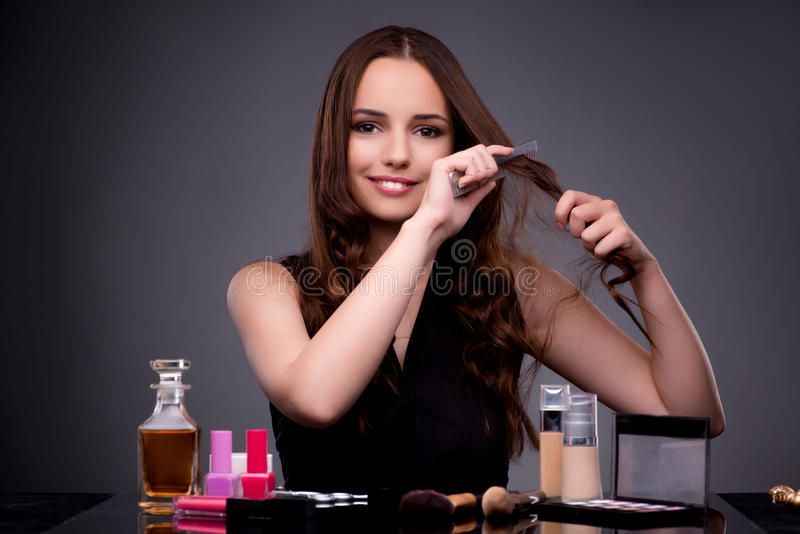 The beautiful woman applying make-up in fashion concept. Beautiful woman applying make-up in fashion concept royalty free stock photos