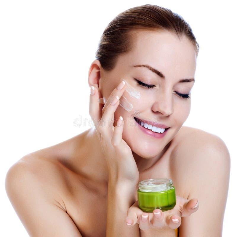 Download Beautiful Woman Applying Moisturizer Cream Stock Photo - Image: 26361602