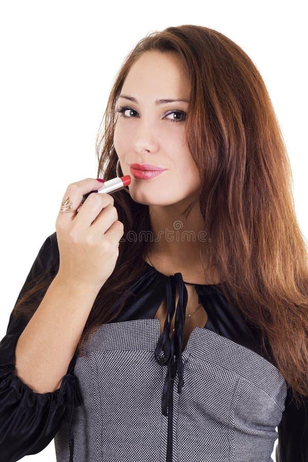 Beautiful Woman Applying Red Lipstick Royalty Free Stock Image