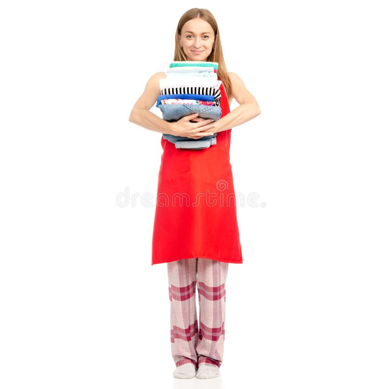 Beautiful woman in apron stack towels ironed clean clothes in hand. On white background isolation stock images