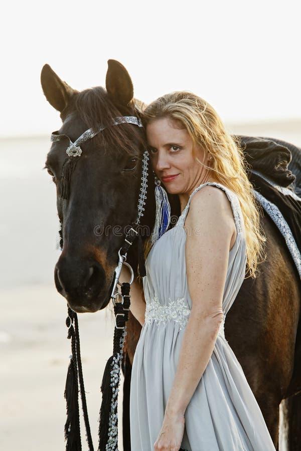 Beautiful woman and arabian horse stock photography