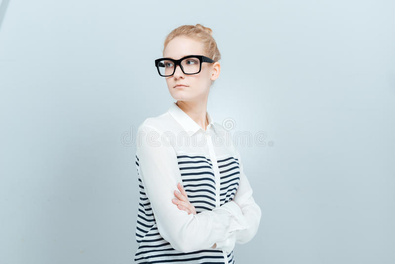 Beautiful woman with arms folded looking away. Isolated on a white background royalty free stock images