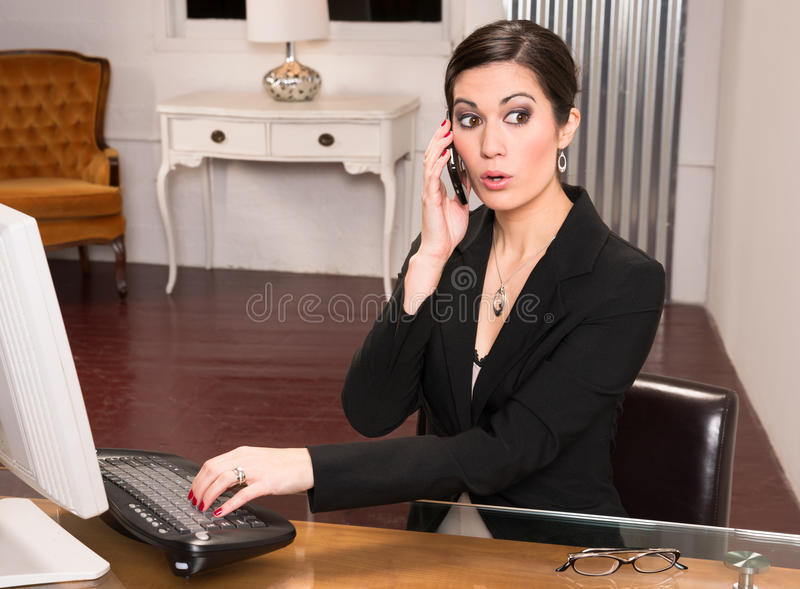 Beautiful Woman Attractive Business Person Office Desk Answering Phone royalty free stock photos