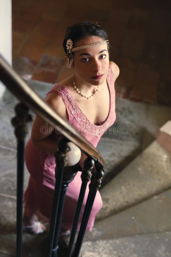Lady in 1920s dress on staircase stock image