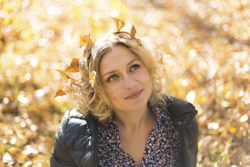 Beautiful woman with autumn leaves royalty free stock photography
