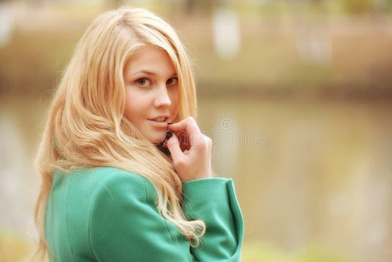 Beautiful woman in autumn park stock photo