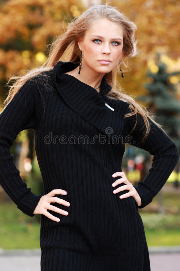 Beautiful woman in autumnal park royalty free stock image