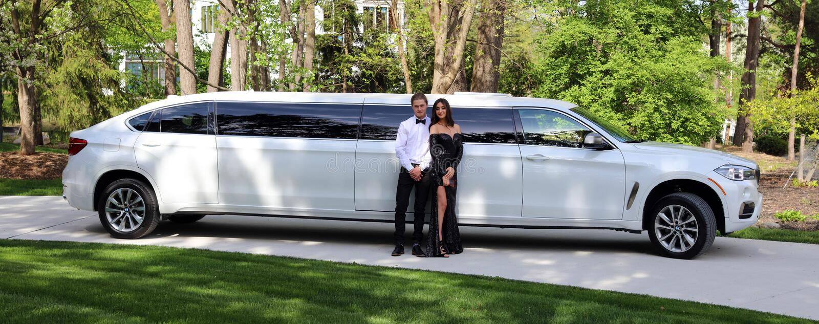 Beautiful woman in back prom dress and handsome guy in suit, teenager ready for a luxury night. stock image