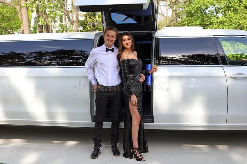 Beautiful woman in back prom dress and handsome guy in suit, teenager ready for a luxury night. stock photos