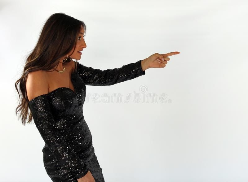 Beautiful woman in back prom dress, teenager ready for a luxury night. Unique gorgeous face, nice smile, wonderful eyes girl. royalty free stock photography