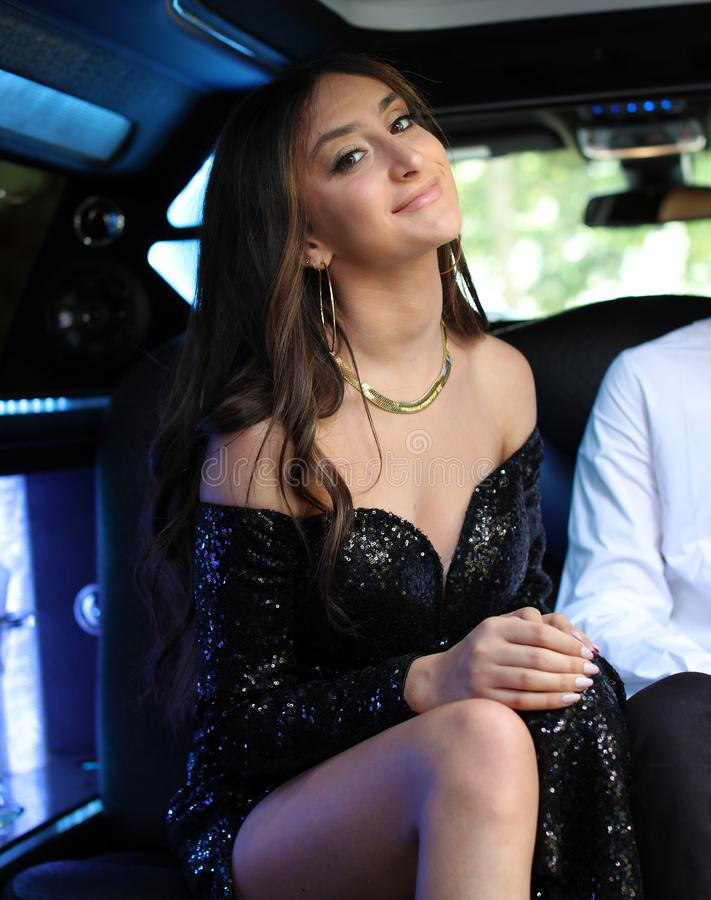 Beautiful woman in back prom dress, teenager ready for a luxury night. Unique gorgeous face, nice smile, wonderful eyes girl. stock photos