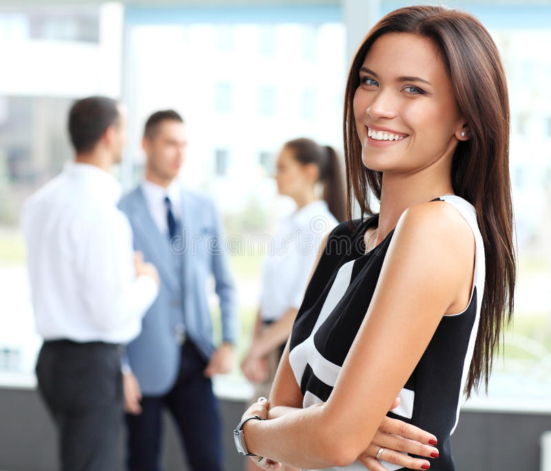 Beautiful woman on the background of business people royalty free stock photos