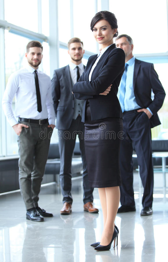 Beautiful woman on the background of business people. Face of beautiful women on the background of business people stock image