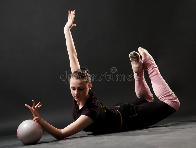 Download Beautiful woman with ball stock photo. Image of flexibility - 9417806