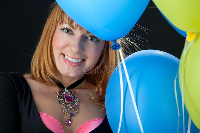 Beautiful woman with balloons stock images