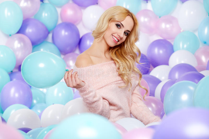 Beautiful woman with balloons stock image