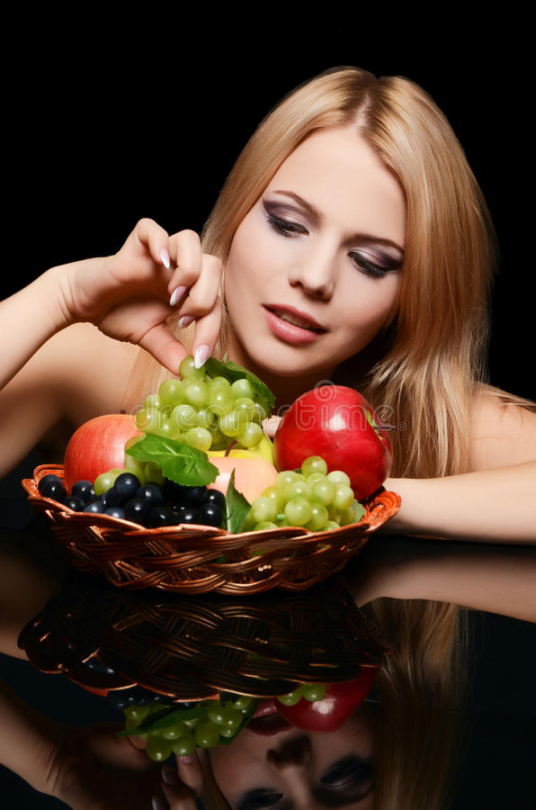 The beautiful woman with basket of fruit royalty free stock photography