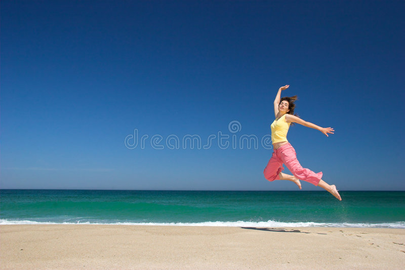 Beautiful woman on the beach royalty free stock photos