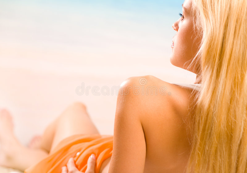 Beautiful woman on the beach stock images