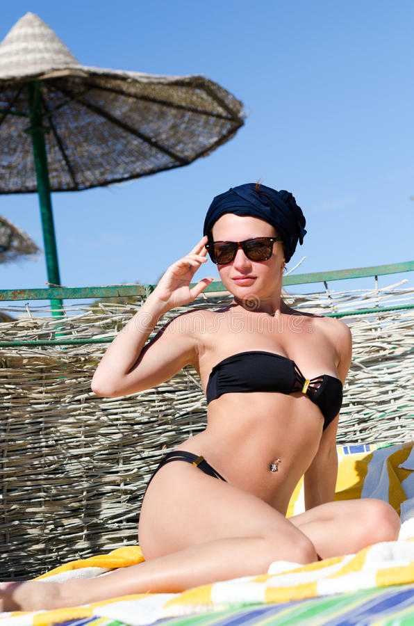 Download Beautiful woman on a beach stock photo. Image of blue - 27986404