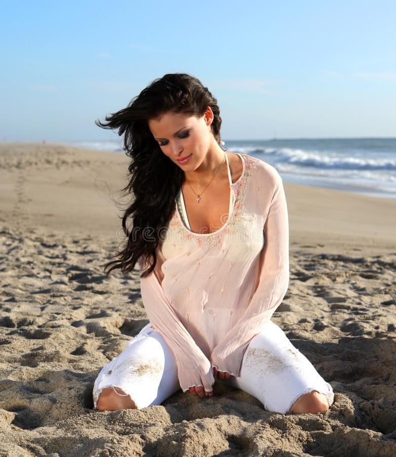 Beautiful woman on the beach royalty free stock image