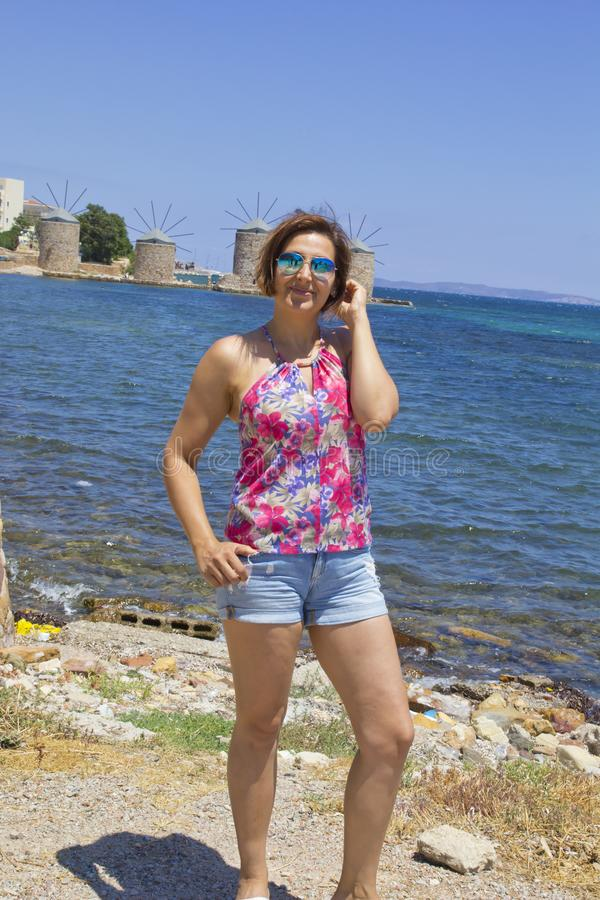 Beautiful woman on the beach in Chios Island royalty free stock image
