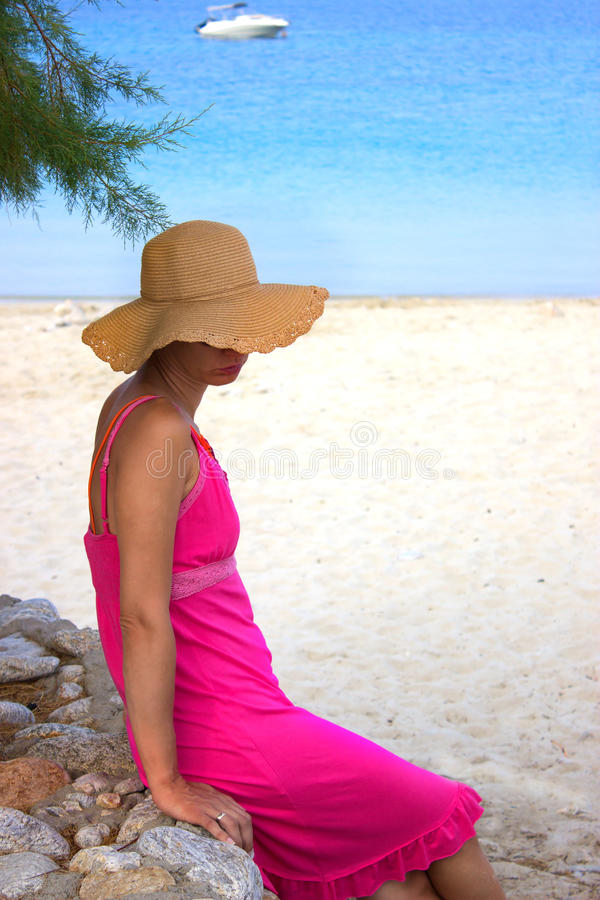 Beautiful woman by the beach in Greece stock photo