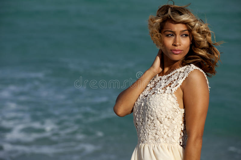 Beautiful woman on beach royalty free stock photography