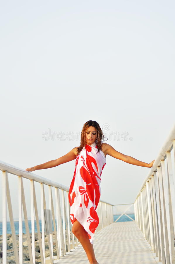 Beautiful woman Beautiful woman posing on moorage royalty free stock photos