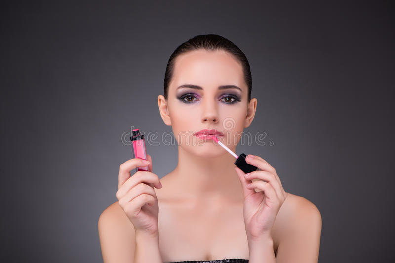 The beautiful woman in beauty concept with lipstick. Beautiful woman in beauty concept with lipstick royalty free stock photo