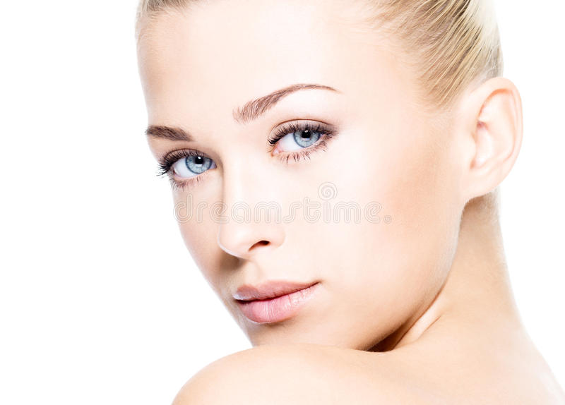 Beautiful woman with beauty skin. Portrait of beautiful young blond woman with clean face. High key shot stock photo