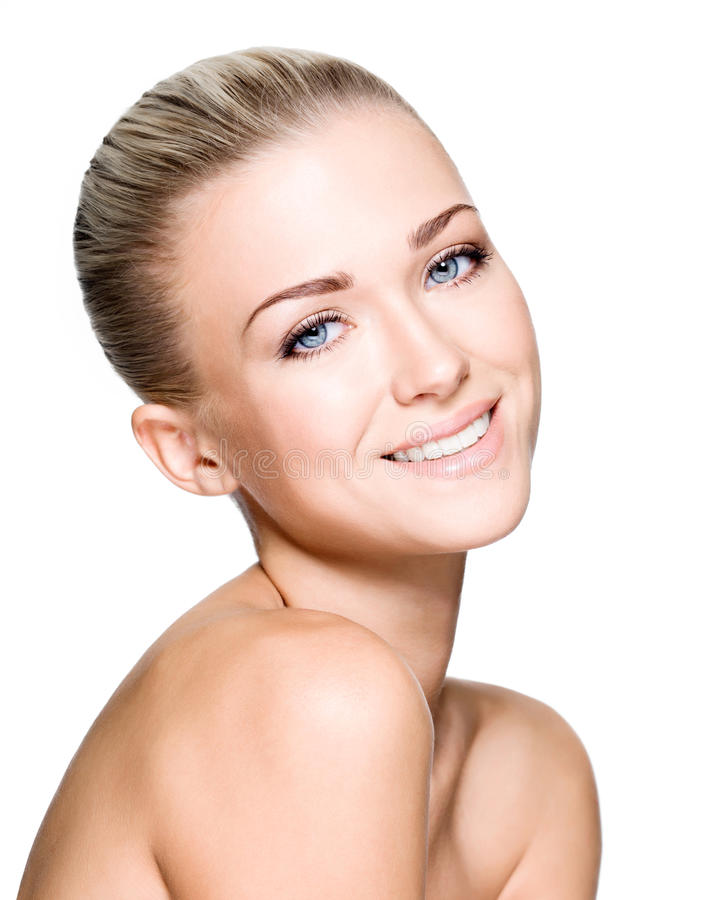 Beautiful woman with beauty smiling face. Side portrait of beautiful smiling woman with clean face - isolated on white stock image