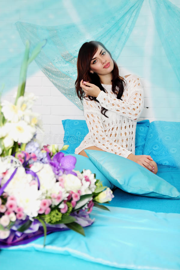 Beautiful woman on the bed royalty free stock images