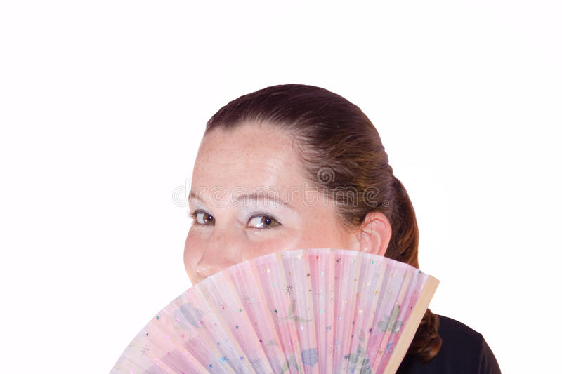 Beautiful Woman Behind A Hand-Held Fan Stock Photos