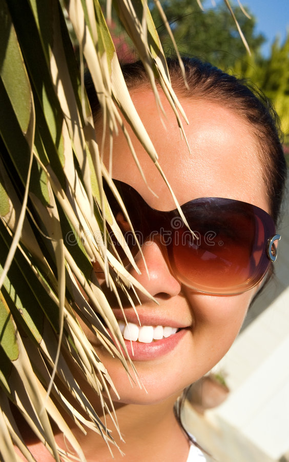 Download Beautiful  Woman Behind The Palm Stock Image - Image: 7983831