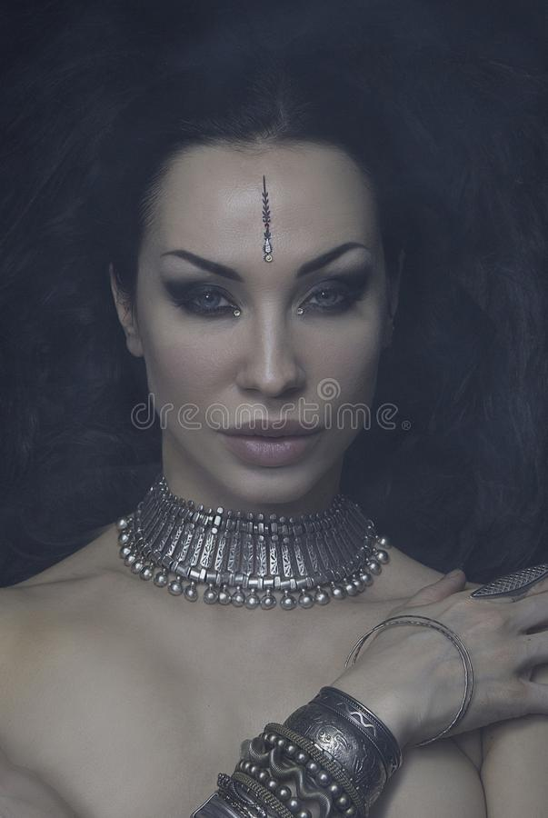 Beautiful Woman Bellydancer with Eastern Makeup and Oriental Jewelry Indian, Arab, African, Egyptian. Tribal Fusion stock photo
