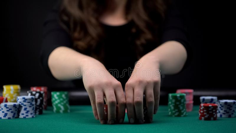 Beautiful woman betting all casino chips, risky poker tournament, gambling. Stock photo royalty free stock photos