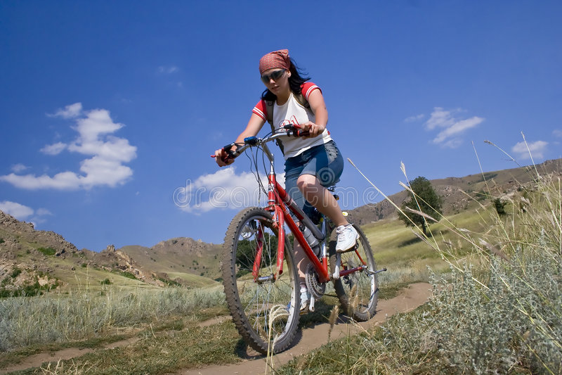Beautiful Woman On A Bicycle Royalty Free Stock Photography