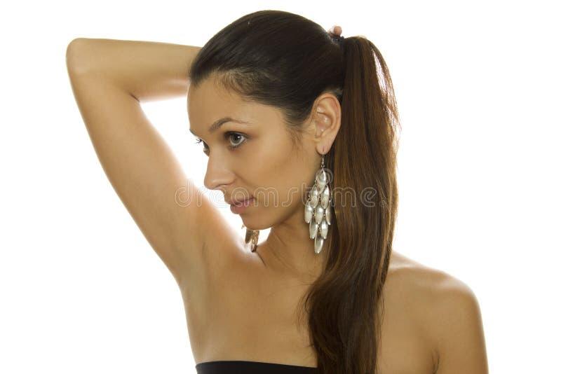 Beautiful woman with big earrings stock photos