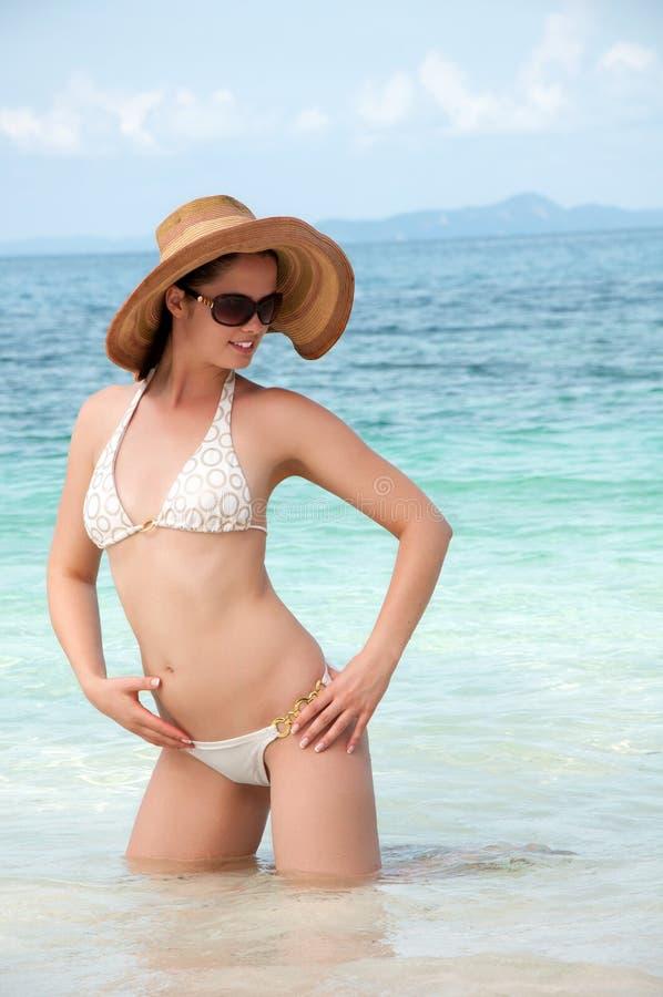 Beautiful woman in bikini bathing in clear sea stock image