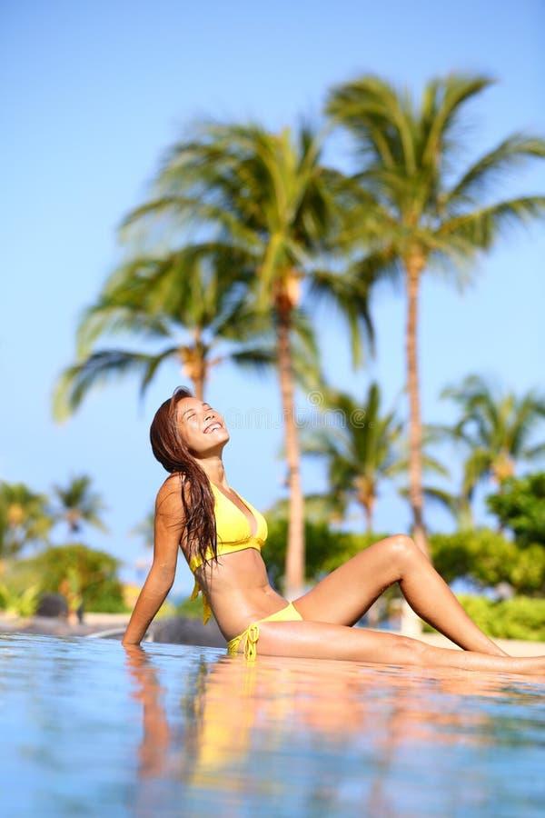Beautiful woman in a bikini sunbathing on travel stock images