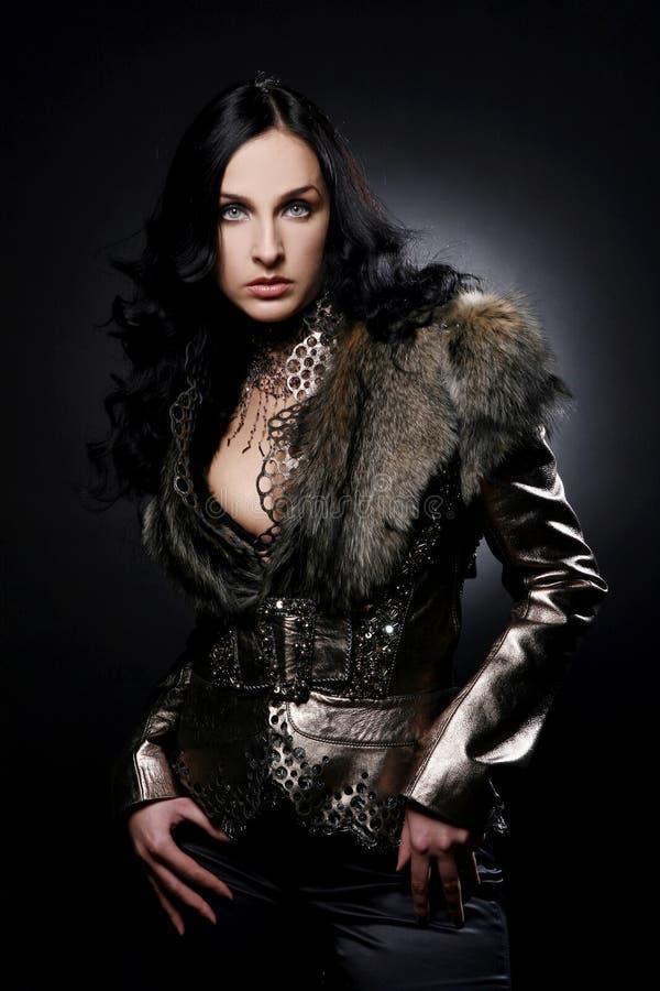 Beautiful woman on black background royalty free stock photo
