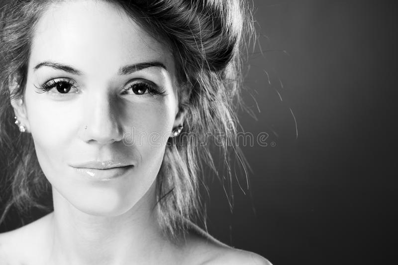 Beautiful woman on black background stock photos