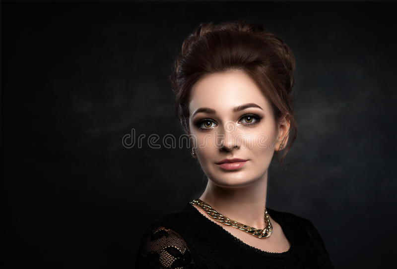 Beautiful woman on black classical dress. Vogue style photo. Beautiful woman on black classical dress pose in studio. Vogue style photo royalty free stock photography
